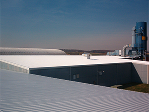 After picture of a commercial cool roof installed at a facility