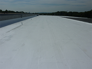 A flat roof with a white coating applied on it
