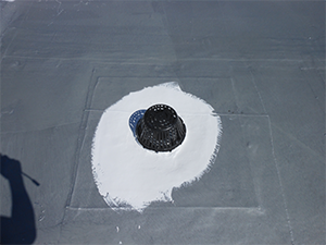 Whiting coating applied on a commercial rooftop