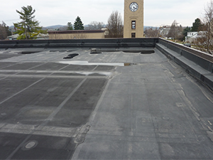 A rooftop with a rubber membrane