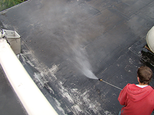 A worker applies a protective coating