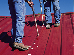 Screws are covered on a metal roof
