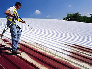 Commercial roof coating on a metal roof