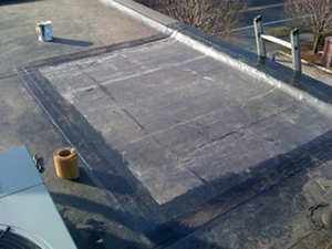 Rubber roofing repair applied on a commercial roof
