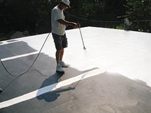 White coating is applied on a roof membrane